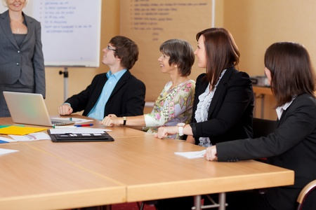 Business group of people attending and listening to a presentation in the office photo