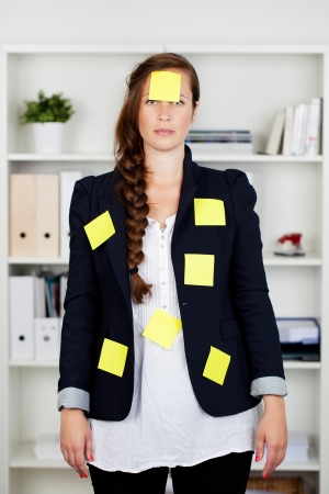 abdomen yellow jacket: Beautiful Caucasian businesswoman standing in the office with post it notes on her body