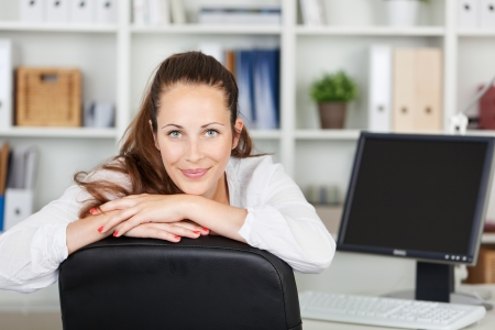 Image of a beautiful young woman posing while working on her computer. photo