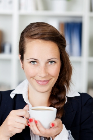 Beautiful Young Woman Smiling With Coffee Mug photo