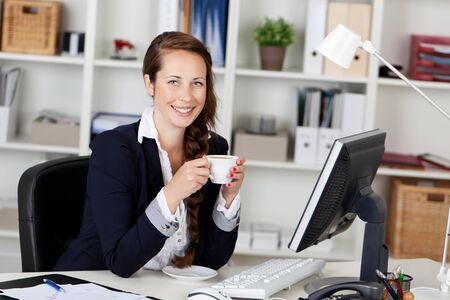 work station: Woman Executive Drinking Coffee at work station