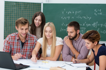 diverse students: Group activity in the classroom with a diverse multiethnic group of college or university students gathered together at a table working