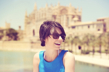 holidaying: Laughing beautiful young woman in sunglasses holidaying in Mallorca on a hot sunny summer day