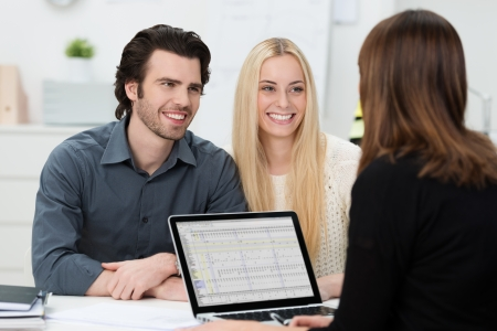 banker: Young attractive couple during an interview at an office Stock Photo