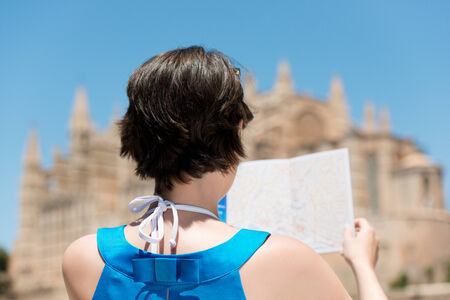 Rear view shot of woman draw the blurred cathedral in palma photo