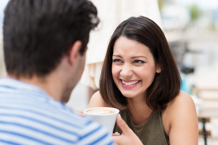 latin: Happy couple having a great time talking over a cup of coffee Stock Photo