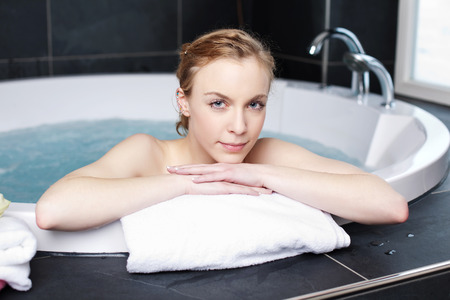 Woman Soaking In A Bath Tub With Just Her Face Above The Water ...