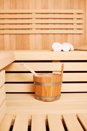 finnish: Interior of wooden sauna with bucket Stock Photo