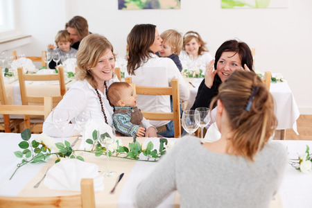 socializing: Group of happy family with children at table in restaurant