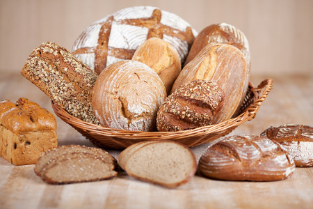 displayed: Variety of breads displayed in bread basket at bakery