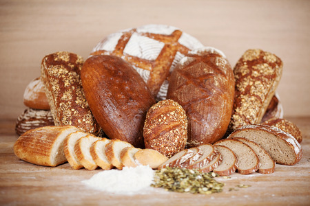 variant: Variety of breads displayed on table at bakery