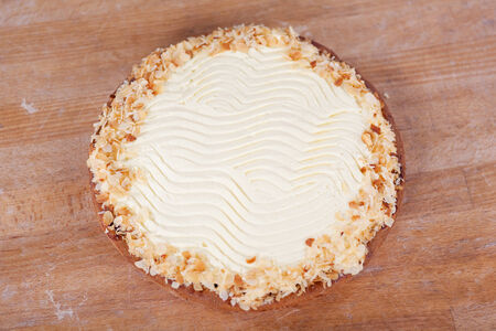 unhealthful: High angle view of cream pie on wooden table at bakery Stock Photo