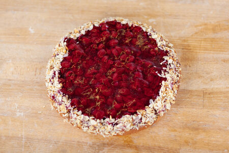 unhealthful: High angle view of raspberry pie on wooden table at bakery
