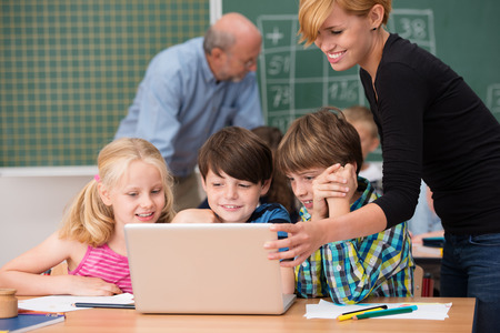 Teaching Assistant Images & Stock Pictures. Royalty Free Teaching ...