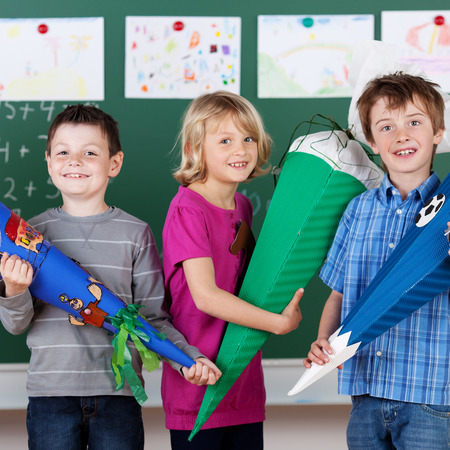 Group of children presents their school project in front of class photo
