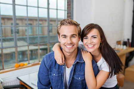 domiciles: Close up Young Smiling Boyfriend and Girlfriend Inside the House Looking at Camera