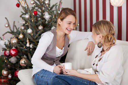 women talking and drinking coffee on christmas day photo