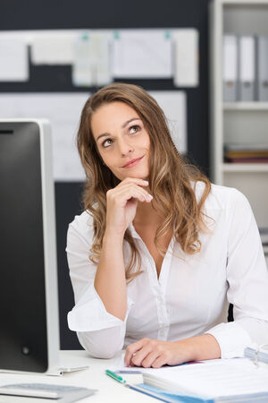 carreer: Close up Thoughtful Office Woman in White Long Sleeve Shirt Sitting at her Worktable with Computer.