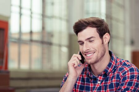 happy young man: Close up Happy Handsome Young Man Talking to Someone Through Mobile Phone. Stock Photo
