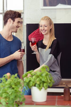 sweethearts: Happy Young Sweethearts Having Glasses of Red Wine While Staying at Home