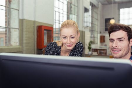 net meeting: Close up Smiling Man and Woman Looking at Computer Screen. Stock Photo