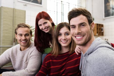 Close up Circle of Young Adult White Friends in Casual Outfits Looking at the Camera with Happy Facial Expression. photo
