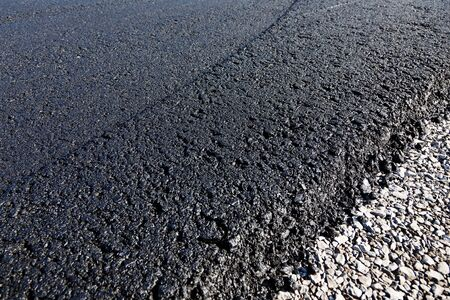 undeveloped: Close up view of newly laid asphalt or tar on the surface of a road Stock Photo