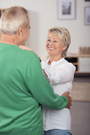 old age: Happy In Love Middle Aged Couple Dancing So Sweet While Looking Each Other in Living Room.