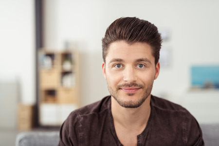 boy beautiful: Portrait of a Handsome Young Bearded Guy Looking at the Camera with a Happy Facial Expression. Stock Photo