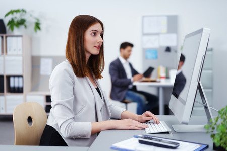 personal assistant: female and male colleague at work at the office Stock Photo