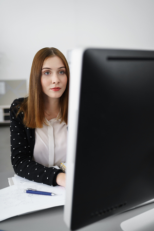 portrait of a creative businesswoman focused on computer screen