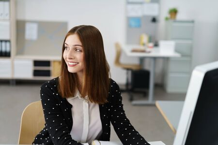 turn over: portrait of a beautiful smiling business woman looking away