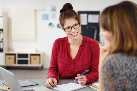 cooperating: motivated businesswomen in a meeting at the workplace Stock Photo