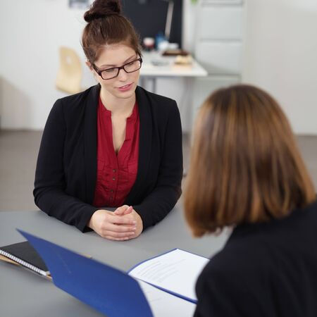 job vacancies: young woman in a job interview talking to a female manager