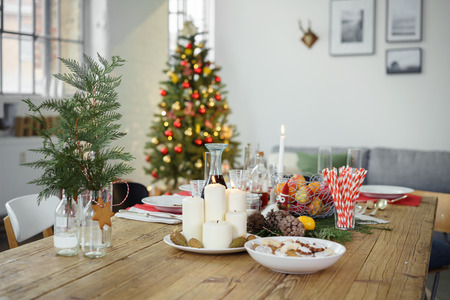 festive table with christmas tree in background