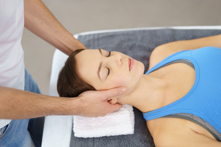 physical therapist: Close up Young Woman Having a Head Massage Therapy by a Physical Therapist with Eyes Closed. Stock Photo