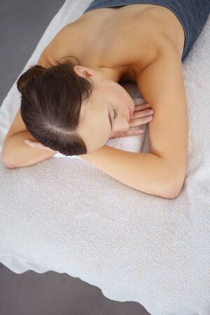 high angle view: high angle view of a woman lying on a bed waiting for a massage in a spa