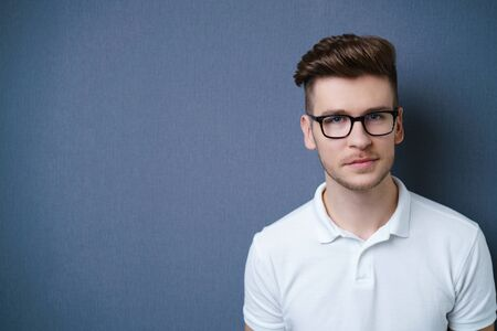 unemotional: Handsome young man with glasses and a serious thoughtful expression Stock Photo