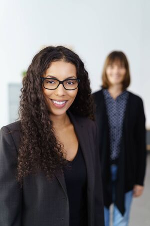 competent: Cheerful African-American female executive worker with partner