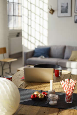 furniture home: Wooden Table Inside a House with Christmas Elements, Laptop Computer and Red Cups