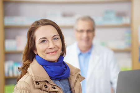 the best medicine attractive stylish middle aged woman with a lovely smile standing looking - Best Camera For Medical Photography