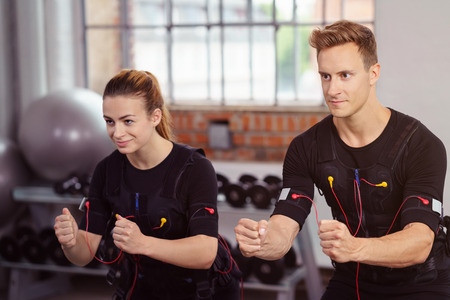 neuromuscular: Male and female athlete wearing black workout top and strapped to heart monitors Stock Photo