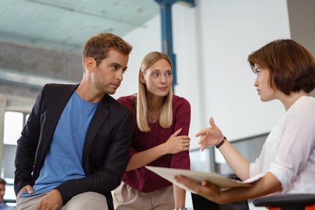 bad planning: Three male and female people gesturing while meeting about something in small office Stock Photo