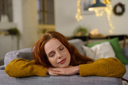 beautiful redhead woman enjoying a quiet moment at home