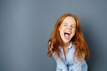 Redhead teen opens her mouth wide