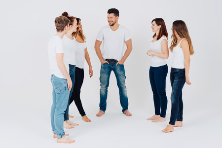 Five Barefoot Young Men And Women In Jeans Standing In A Semi