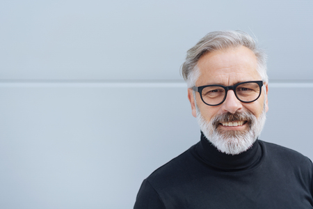 Smiling middle-aged man with a friendly smilelooking at the camera Foto de archivo