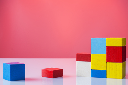logical: Abstract construction from wooden blocks with copy space. The concept of logical thinking, geometric shapes.