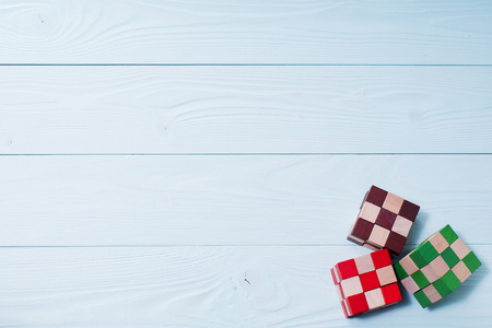 logical: Logic background. The concept of logical thinking. Multi-colored wooden blocks on a blue wooden background.