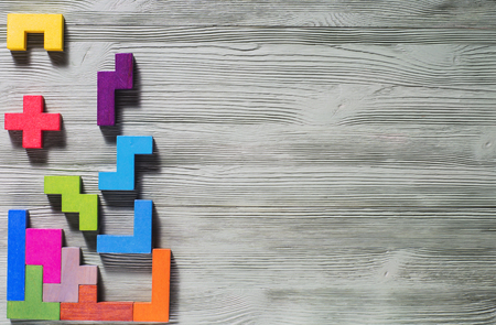 logical: The concept of logical thinking. Geometric shapes on a wooden background.  Tetris toy wooden blocks. Stock Photo